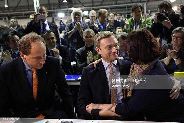 Christian Lindner head of the German Free Democratic Party in North RhineWestphalia is congratulated by party member Angela Freimuth as he learns he...