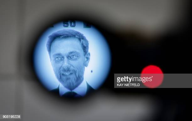 Christian Lindner leader of Germany's free democratic FDP party is seen through a camera viewfinder during a press conference following a session of...