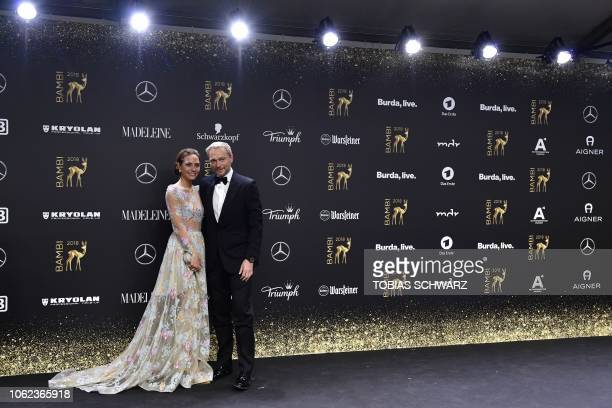 Christian Lindner, leader of Germany's Free Democratic Party FDP, and his girlfriend Franca Lehfeld pose on the red carpet as they arrive for the...