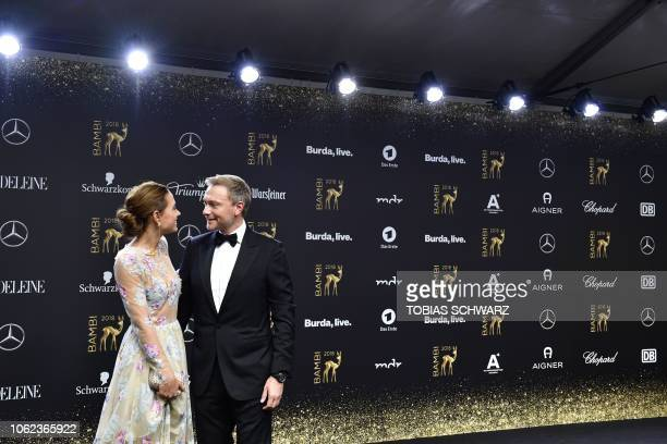 Christian Lindner leader of Germany's Free Democratic Party FDP and his girlfriend Franca Lehfeld pose on the red carpet as they arrive for the Bambi...