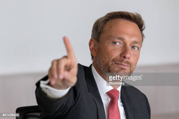 Christian Lindner leader of the Free Democratic Party gestures while speaking ahead of a Bloomberg Television interview in Berlin Germany on Thursday...
