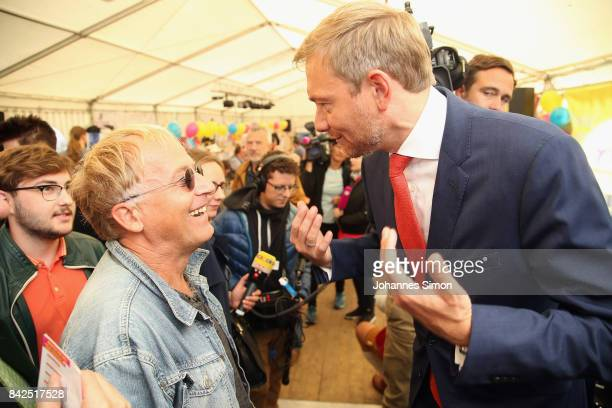 Christian Lindner of the FDP talks with fans at the Gillamoos amusement fair on September 4 2017 in Abensberg Germany Politicians among them...