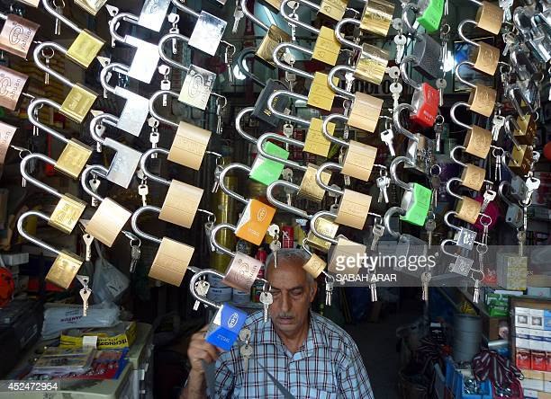 A Christian locksmith sits in his shop in Rashid street in central Baghdad's main commercial district on July 21 2014 Christians were fleeing Iraq's...