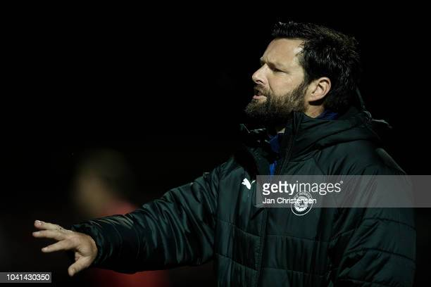 Christian Lonstrup head coach of FC Roskilde gives instructions during the Danish SYDBANK Pokalen Cup match between FC Roskilde and AaB Aalborg at...