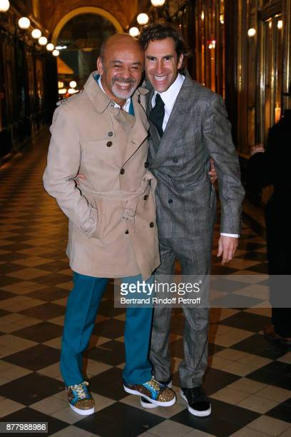 Christian Louboutin and coowner of the Boutique Pierre Pelegry attend the Ligne Blanche Boutique Opening at Galerie VeroDodat on November 23 2017 in...