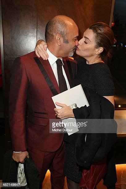 Christian Louboutin and Daphne Roulier attend the Berluti Flagship Store Opening on November 26 2013 in Paris France
