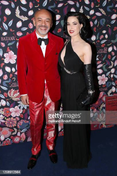 Christian Louboutin and Dita Von Teese attend the Harper's Bazaar Exhibition as part of the Paris Fashion Week Womenswear Fall/Winter 2020/2021 At...