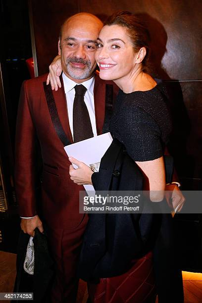 Christian Louboutin and journalist Daphne Roulier attend Berluti Flagship Store Opening on November 26 2013 in Paris France
