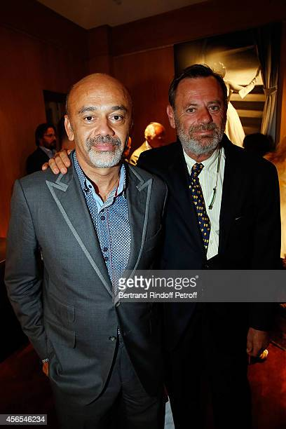 "Christian Louboutin and Louis Benech attend ""Monsieur Dior Il etait une fois..."" book signingin Galerie Passebon on October 2, 2014 in Paris, France."