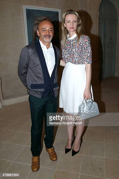 Christian Louboutin and Louis Vuitton's executive vice president Delphine Arnault attend the Berluti Menswear Spring/Summer 2016 show as part of...
