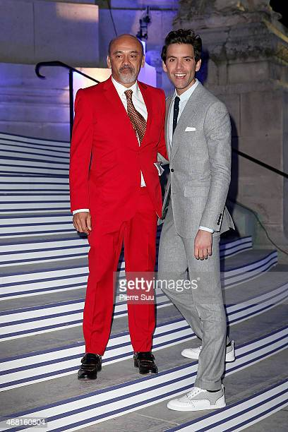 Christian Louboutin and Mika attend the 'Jean Paul Gaultier' Exhibition at Grand Palais on March 30 2015 in Paris France