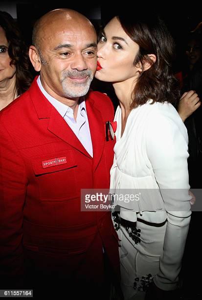 Christian Louboutin and Olga Kurylenko attend the Christian Dior show as part of the Paris Fashion Week Womenswear Spring/Summer 2017 on September 30...
