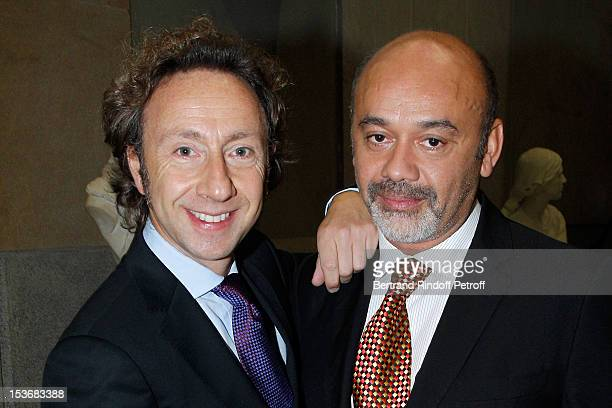 Christian Louboutin and Stephane Bern at Musee d'Orsay on October 8 2012 in Paris France