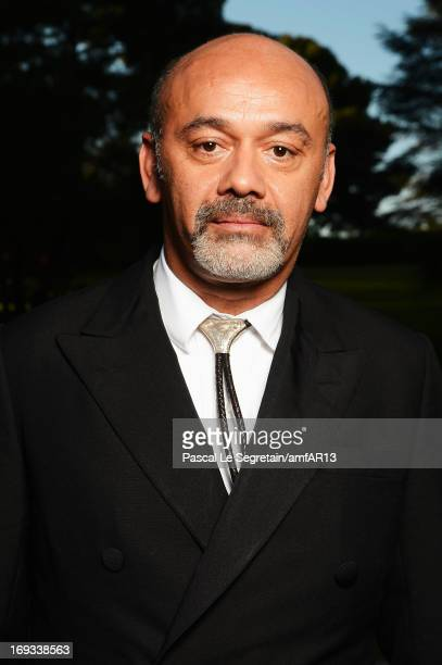 Christian Louboutin attends amfAR's 20th Annual Cinema Against AIDS during The 66th Annual Cannes Film Festival at Hotel du CapEdenRoc on May 23 2013...