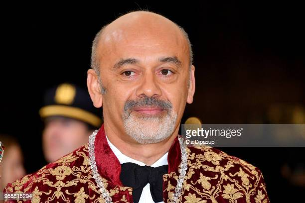 Christian Louboutin attends the Heavenly Bodies Fashion The Catholic Imagination Costume Institute Gala at The Metropolitan Museum of Art on May 7...