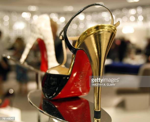 Christian Louboutin heels are seen on display as Saks Fifth Avenue unveils 17 August 2007 10022SHOE the new designer shoe floor that's so big it has...