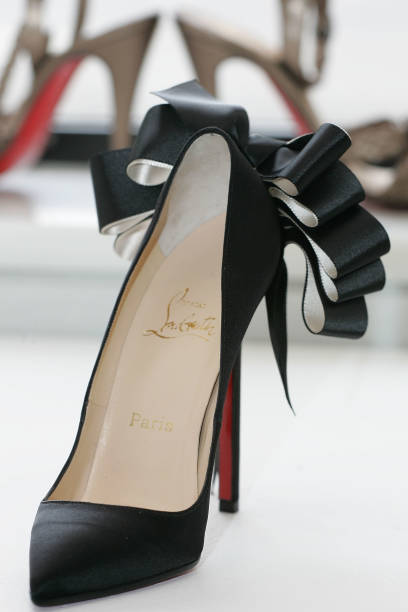 472f92f55c64 promo code louboutinbilleetboulestuddedpumps ccbbd bc0b1  best price christian  louboutin shoes are displayed at the launch of his fall collection at  barneys