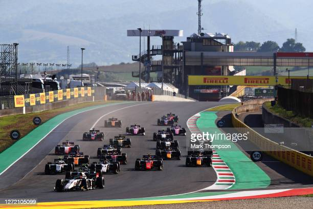 Christian Lundgaard of Denmark and ART Grand Prix leads the field into turn one at the start during the Formula 2 Championship Feature Race at...