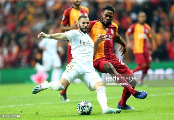 Christian Luyindama of Galatasaray and Karim Benzama of Real Madrid vie for the ball during the UEFA Champions League Group A match between...