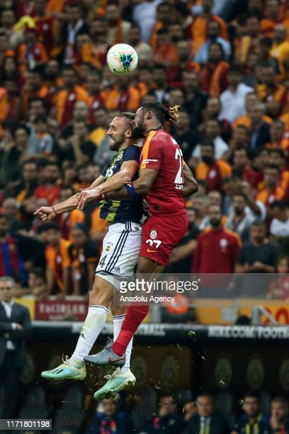 Christian Luyindama of Galatasaray in action against Vedat Muriqi of Fenerbahce during the Turkish Super Lig soccer match between Galatasaray and...
