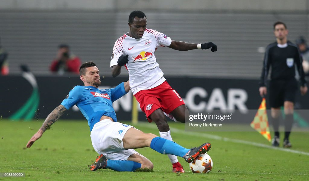 Christian Maggio (L) of Napoli and Bruma (R) of Leipzig compete during the UEFA Europa League Round of 32 match between RB Leipzig and Napoli at the Red Bull Arena on February 22, 2018 in Leipzig, Germany.