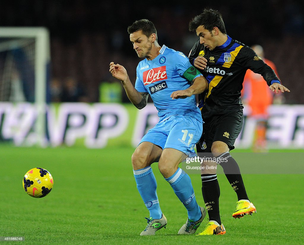 Christian Maggio of Napoli and Nicola Sansone of Parma in action during the Serie A match between SSC Napoli and Parma FC at Stadio San Paolo on November 23, 2013 in Naples, Italy.