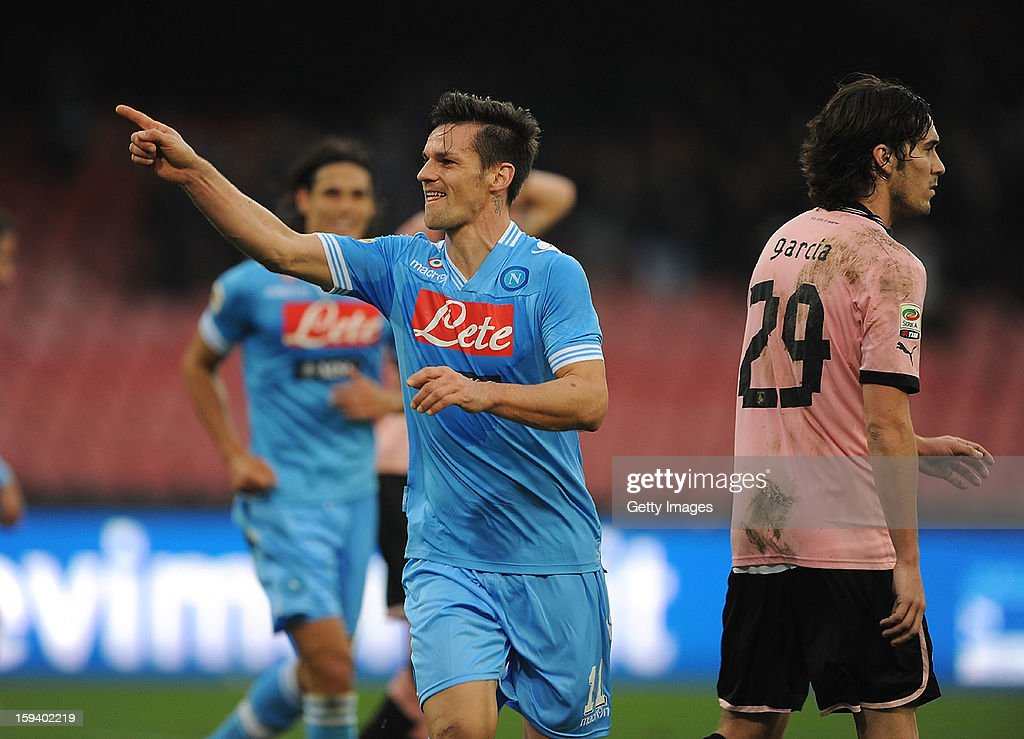 Christian Maggio of Napoli celebrates scoring the opening goal of the match during the Serie A match between SSC Napoli and US Citta di Palermo at Stadio San Paolo on January 13, 2013 in Naples, Italy.