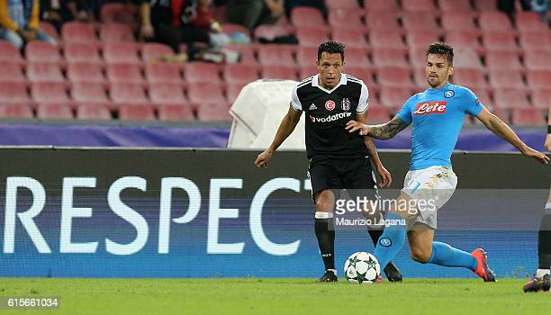 Christian Maggio of Napoli competes for the ball with Adriano of Besiktas during the UEFA Champions League match between SSC Napoli and Besiktas JK...