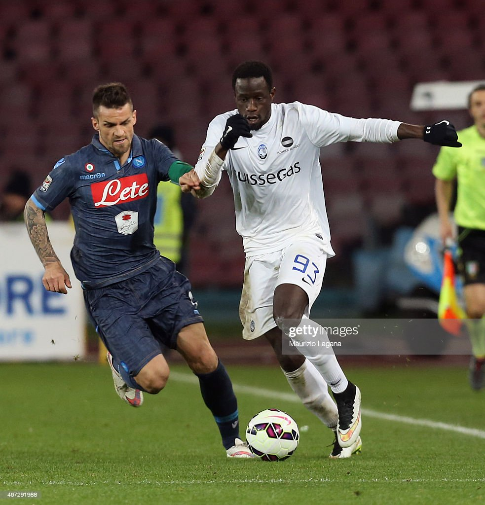 Christian Maggio (L) of Napoli competes for the ball with Boukary Drame of Atalanta during the Serie A match between SSC Napoli and Atalanta BC at Stadio San Paolo on March 22, 2015 in Naples, Italy.