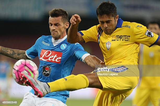 Christian Maggio of Napoli competes for the ball with Eder of Sampdoria during the Serie A match between SSC Napoli and UC Sampdoria at Stadio San...