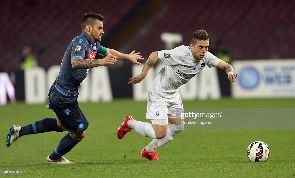 Christian Maggio (L) of Napoli competes for the ball with German Denis of Atalanta during the Serie A match between SSC Napoli and Atalanta BC at Stadio San Paolo on March 22, 2015 in Naples, Italy.