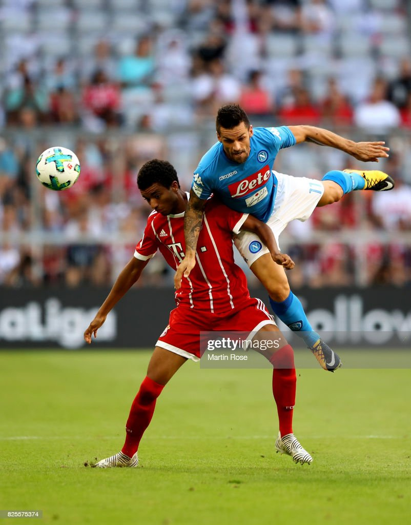 Christian Maggio (R) of Napoloi and Timothy Tilmann of Muenchen battle for the ball during the Audi Cup 2017 match between SSC Napoli and FC Bayern Muenchen at Allianz Arena on August 2, 2017 in Munich, Germany.