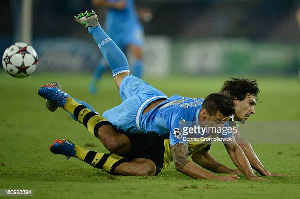 Christian Maggio of SSC Napoli and Mats Hummels of Borussia Dortmund battle for the ball during the UEFA Champions League Group F match between SSC...