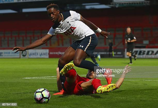 Christian Maghoma of Tottenham beats the challenge from Tiago Llori of Liverpool during the Premier League 2 match between Tottenham Hotspur and...