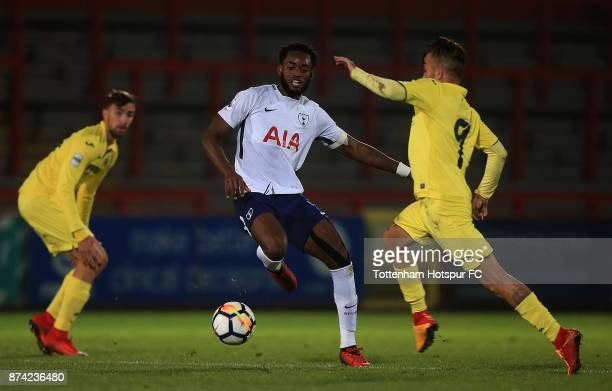 Christian Maghoma of Tottenham holds off pressure from Franco Acosta of Villarreal during the Premier League International Cup match between...