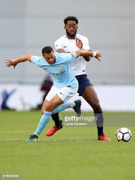 Christian Maghoma of Tottenham Hotspur and Lucas Nmecha of Manchester City during the Premier League 2 match at The Academy Stadium on November 25...