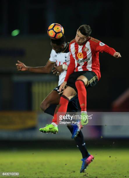 Christian Maghoma of Tottenham Hotspur and Luke Molyneux of Sunderland compete for the ball during the Premier League 2 match between Tottenham...