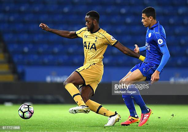 Christian Maghoma of Tottenham Hotspur is closed down by Kairo Mitchell of Leicester City during the Premier League 2 match between Leicester City...