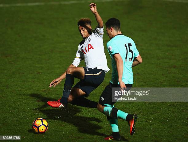 Christian Maghoma of Tottenham tackles Lewis Walker of Derby County during the Premier League 2 match between Tottenham Hotspur and Derby County at...