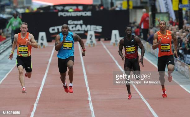 Christian Malcolm beats Mark Lewis Francis to win the Men's 100m event during the Great CityGames on Deansgate Manchester