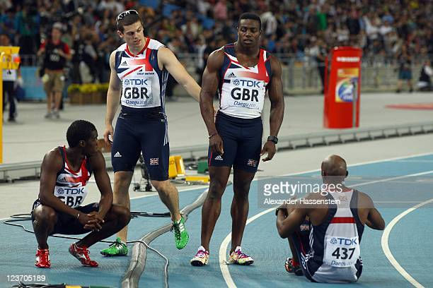 Christian Malcolm Craig Pickering Harry AikinesAryeetey and Marlon Devonish of Great Britain look dejected after failing to finish in the men's 4x100...