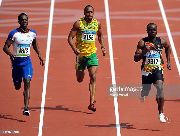 Christian Malcom of Great Britain left Christopher Williams of Jamaica center and Brian Dzingai of Zimbabwe compete in 400meter qualifying in the...