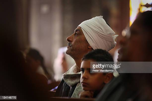 Christian man listens to a sermon in Saint Mark Coptic Orthodox Church in Giza on November 27 2011 in Greater Cairo Egypt There are an estimated 10...