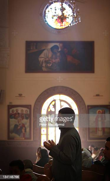 Christian man prays in Saint Mark Coptic Orthodox Church in Giza on November 27 2011 in Greater Cairo Egypt There are an estimated 10 million...