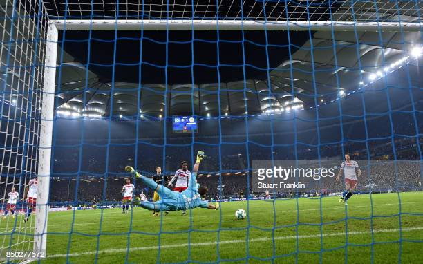 Christian Mathenia of Hamburg can't stop the ball and for PierreEmerick Aubameyang of Dortmund to score Dortmunds second goal to make it 20 during...