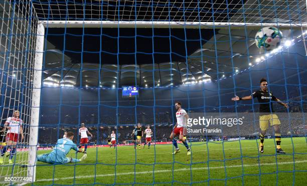 Christian Mathenia of Hamburg can't stop the ball and for Christian Pulisic of Dortmund to score Dortmunds third goal to make it 30 during the...