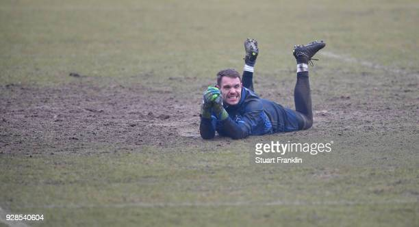 Christian Mathenia of Hamburg lays in the mud during a training session of Hamburger SV at Volksparkstadion on March 7 2018 in Hamburg Germany