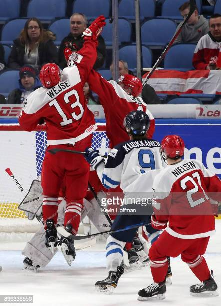 Christian MathiasenWejse of Denmark jumps to knock a puck down in the third period against Finland during the IIHF World Junior Championship at...