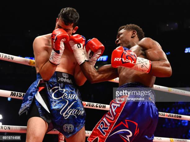 Christian Mbilli of Canada delivers a right upper cut against Cesar Ugarte of Mexico during the WBC light heavyweight world championship match at the...