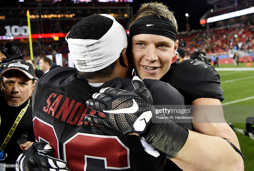 Christian McCaffrey #5 and Barry Sanders #26 of the Stanford Cardinal celebrates after they defeated the USC Trojans in the NCAA Pac-12 Championship game at Levi's Stadium on December 5, 2015 in Santa Clara, California. Stanford won the game 41-22.